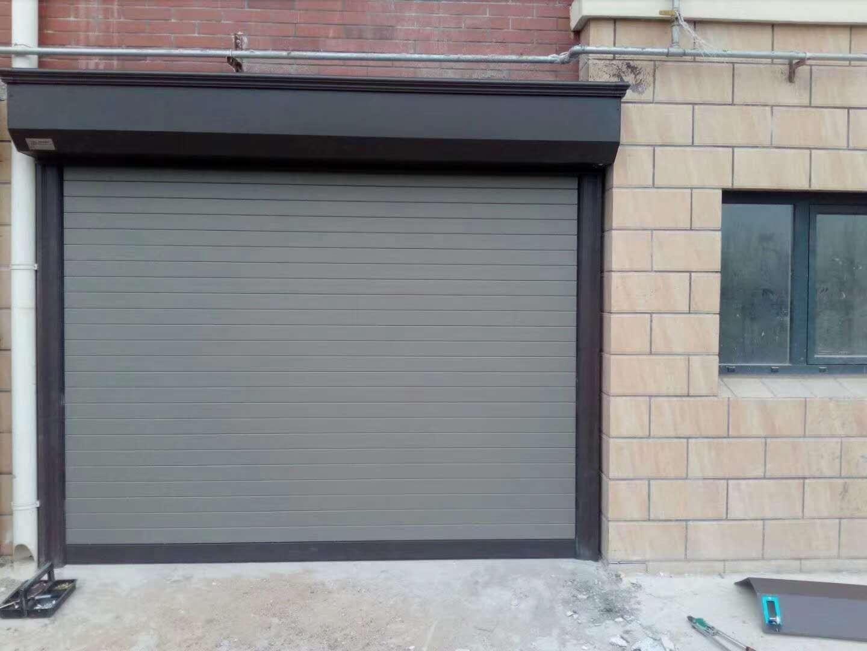 电动卷帘门和翻板门哪个适合用在车库?